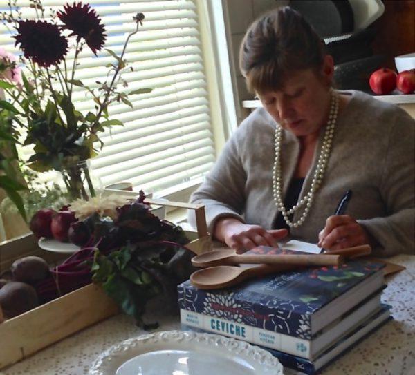 Terri writing in her kitchen